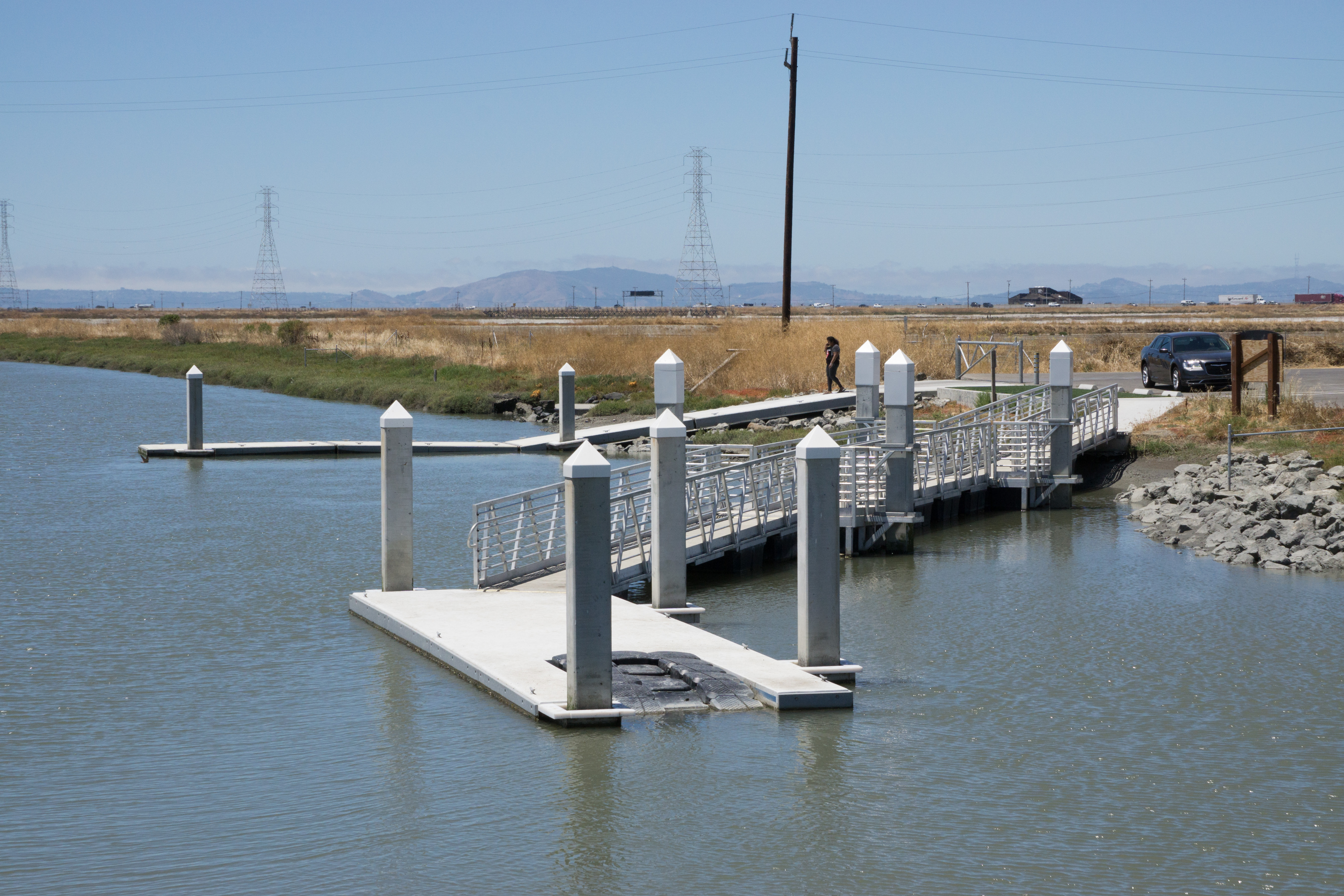 Floating dock with rubber kayak launch