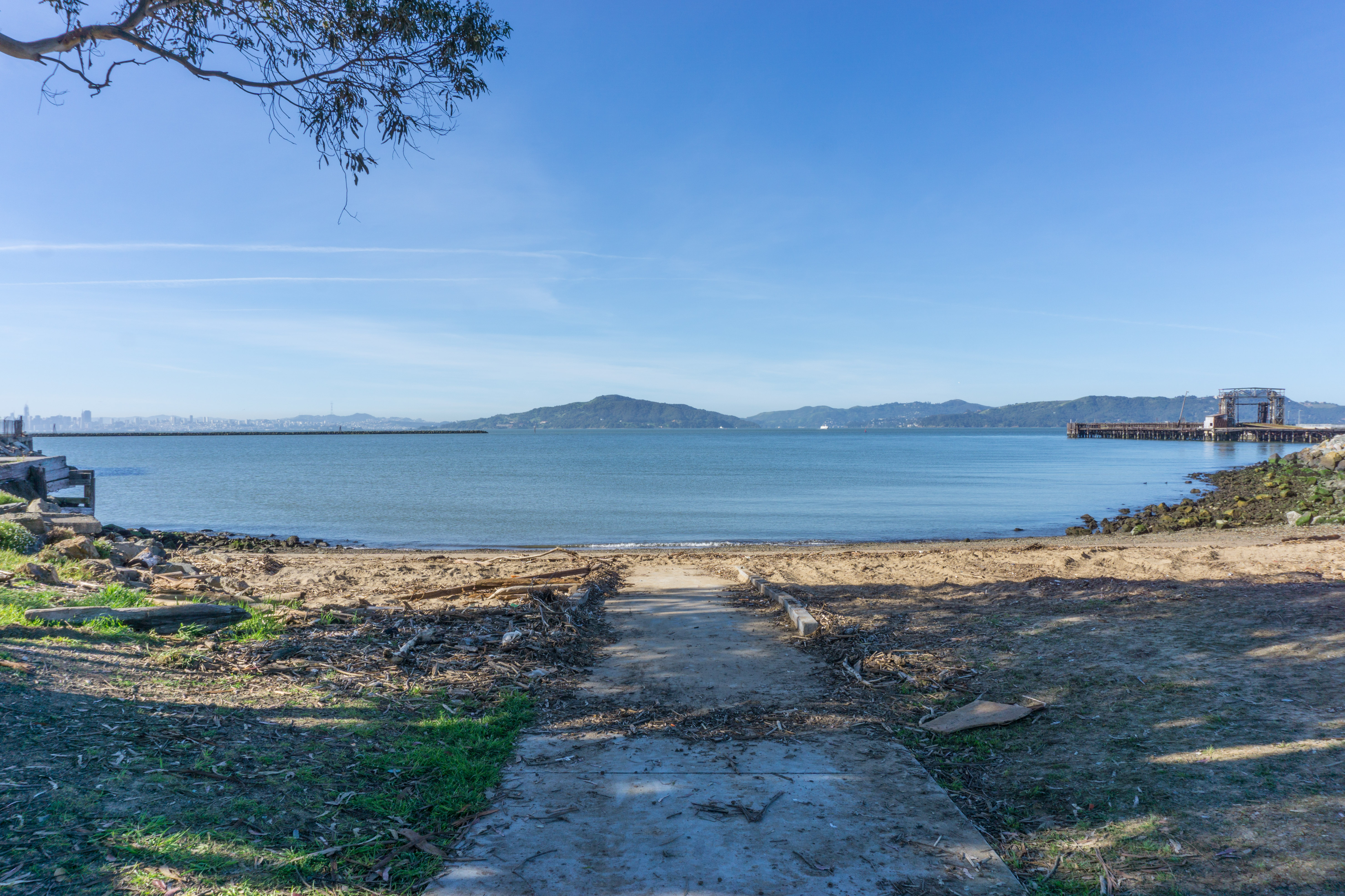 paved path ends at sandy beach