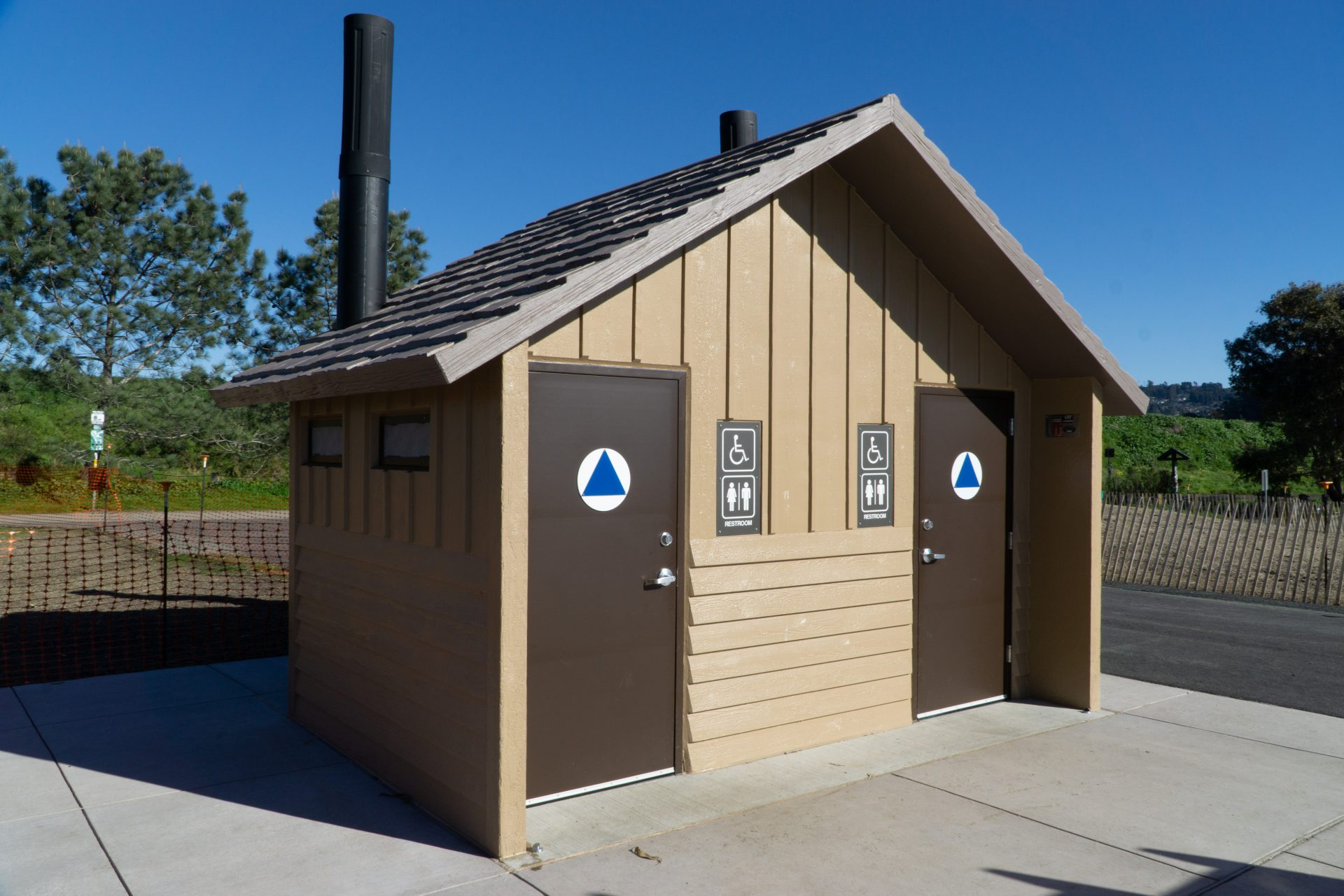 accessible vault toilet building