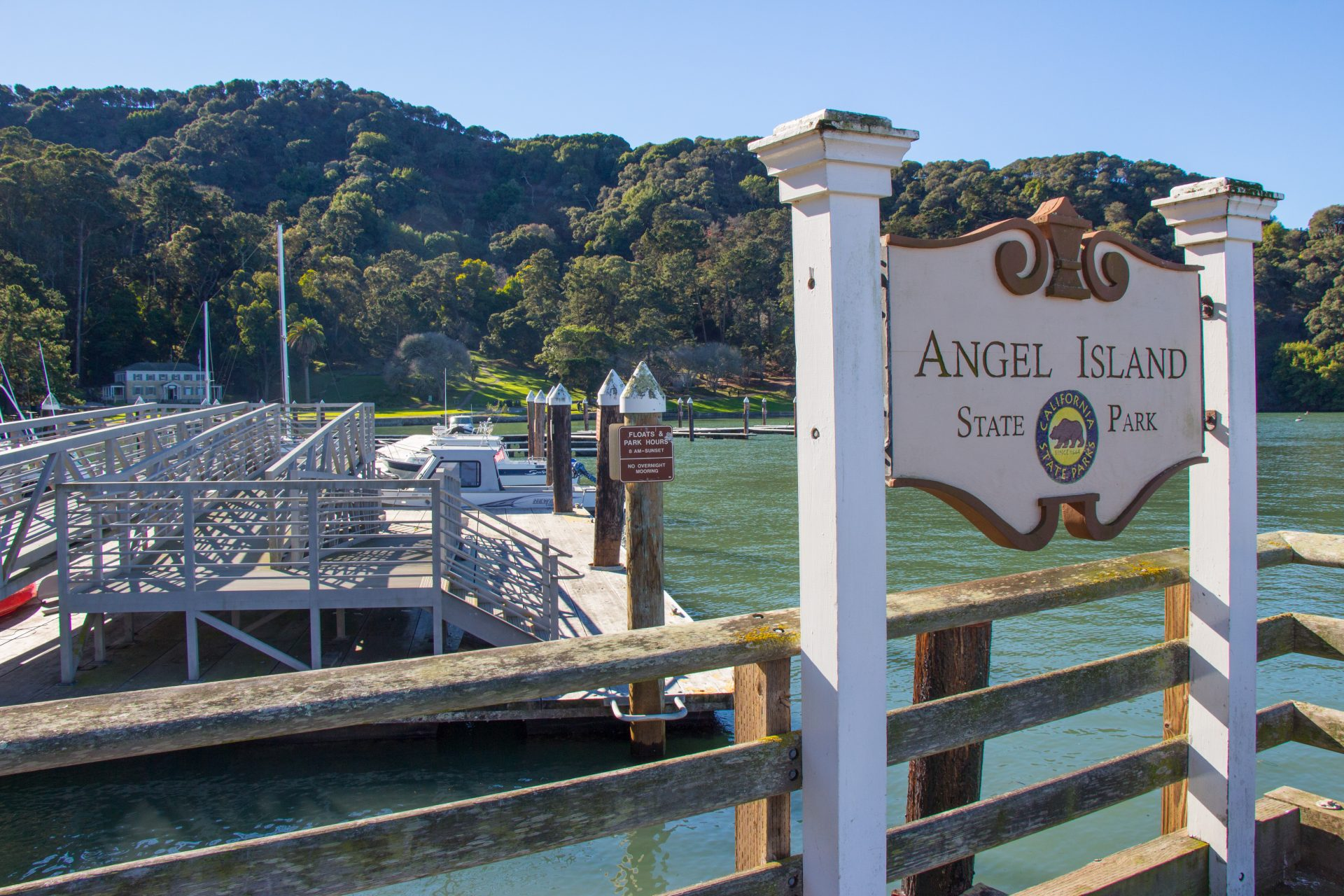 Sign for Angel Island State Park, marina beyond