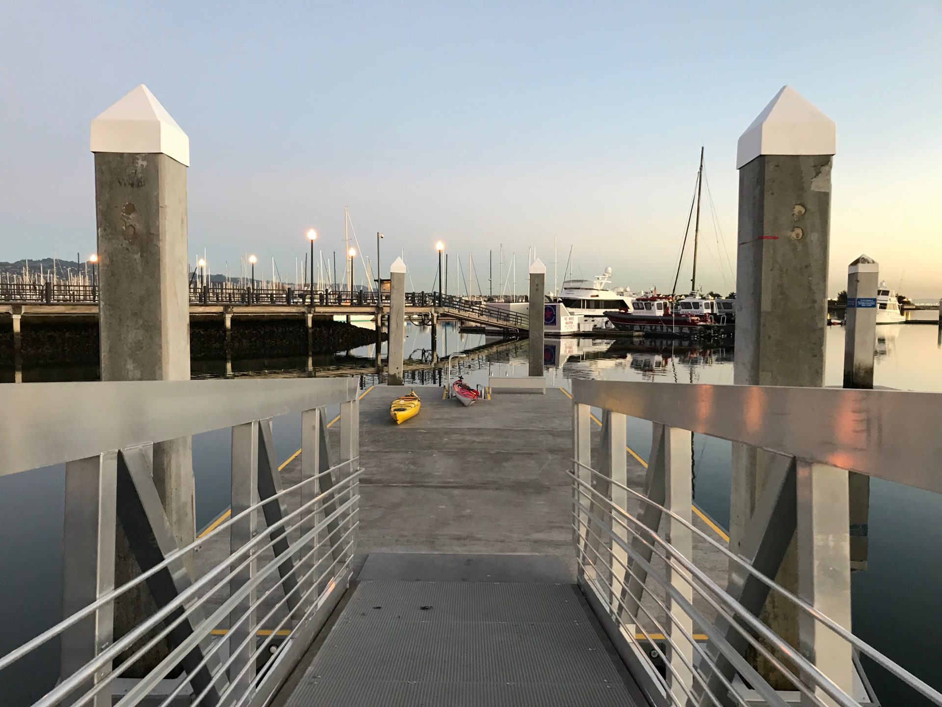 view down ramp to pier with kayaks ready to launch