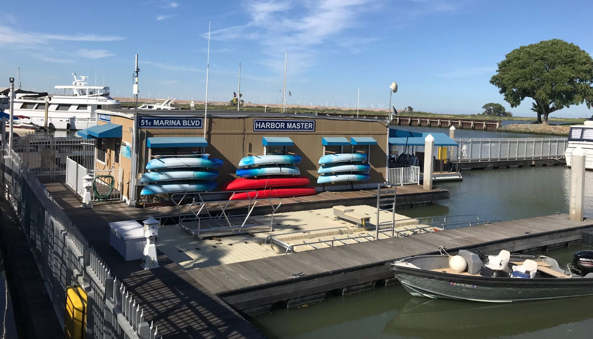 harbor master building with kayaks in racks