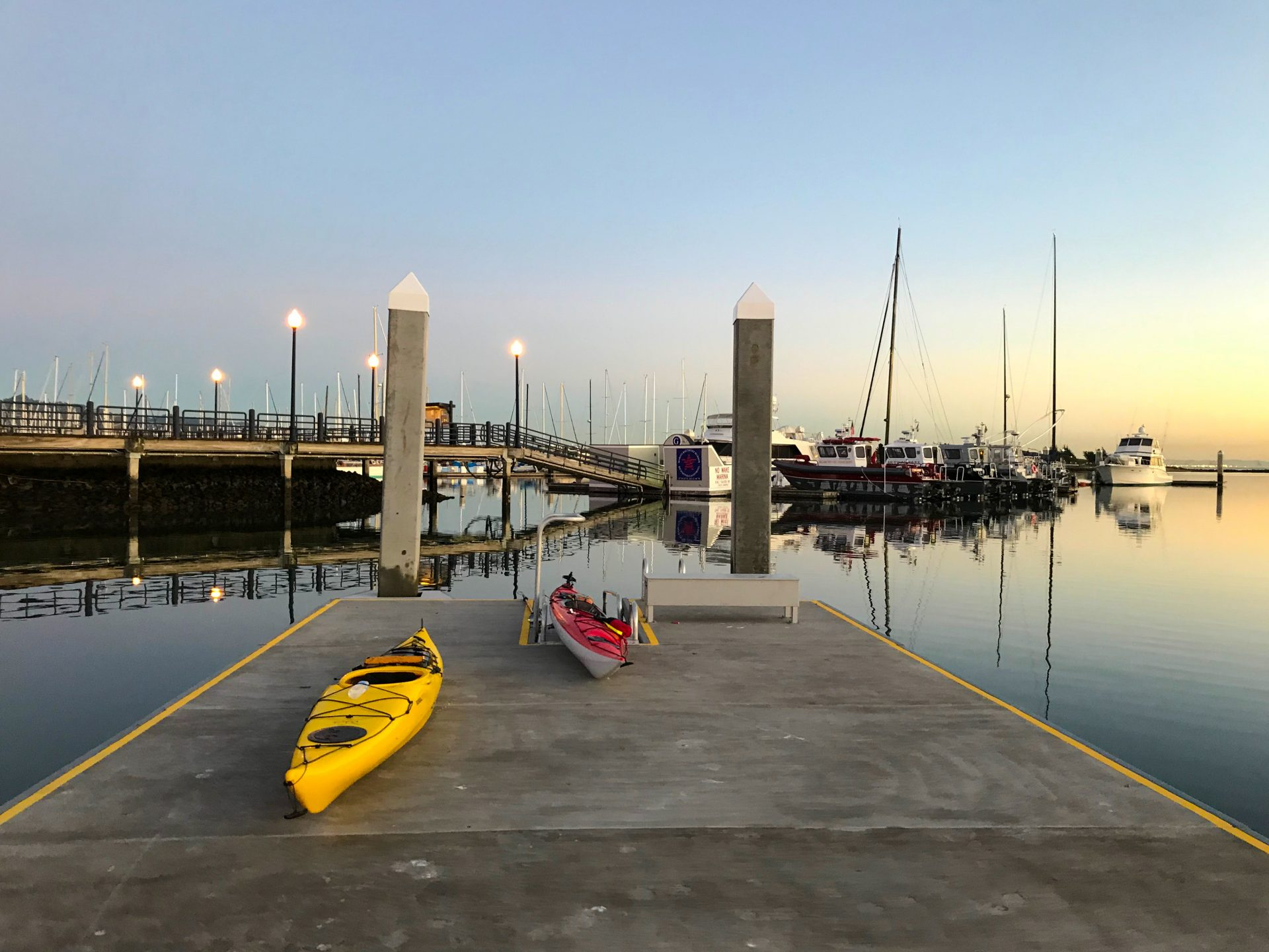 2 kayaks on concrete pier
