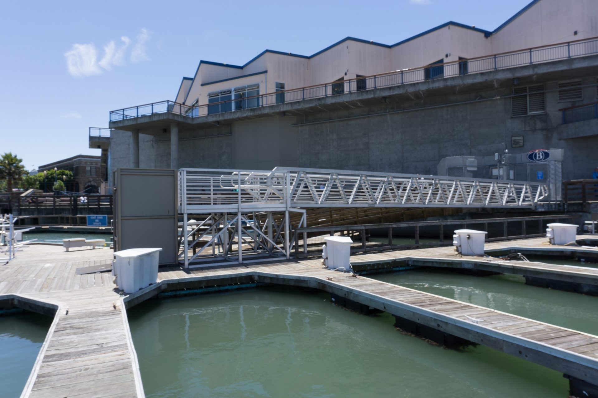 Array of wooden docks with ramp and wheelchair lift in center