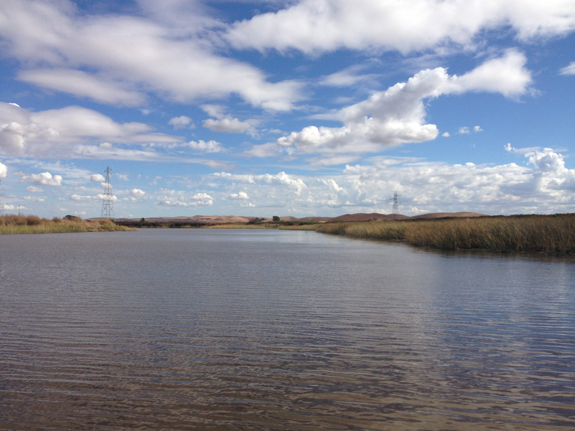wide expanse of water, dramatic cloudy sky