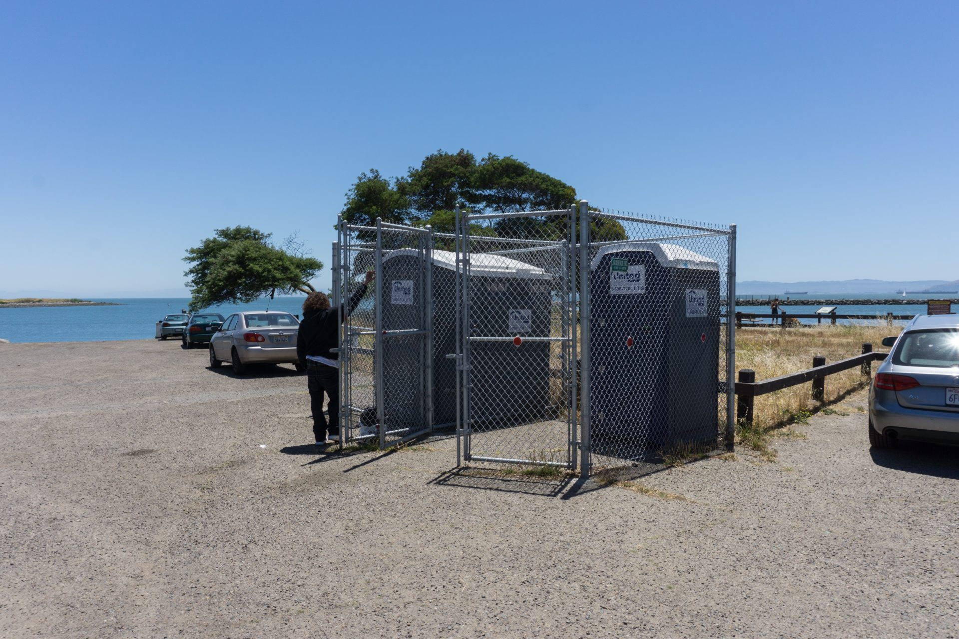 portable toilets inside chainlink enclosure