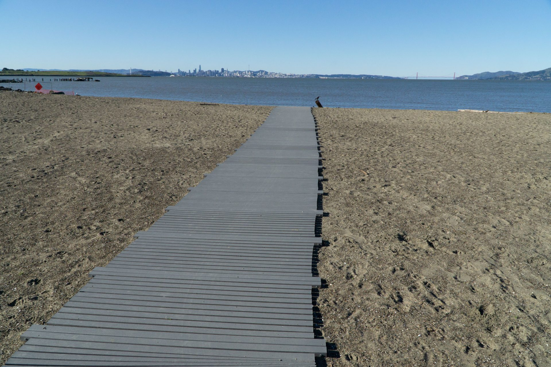 long gangway leading over sand to water