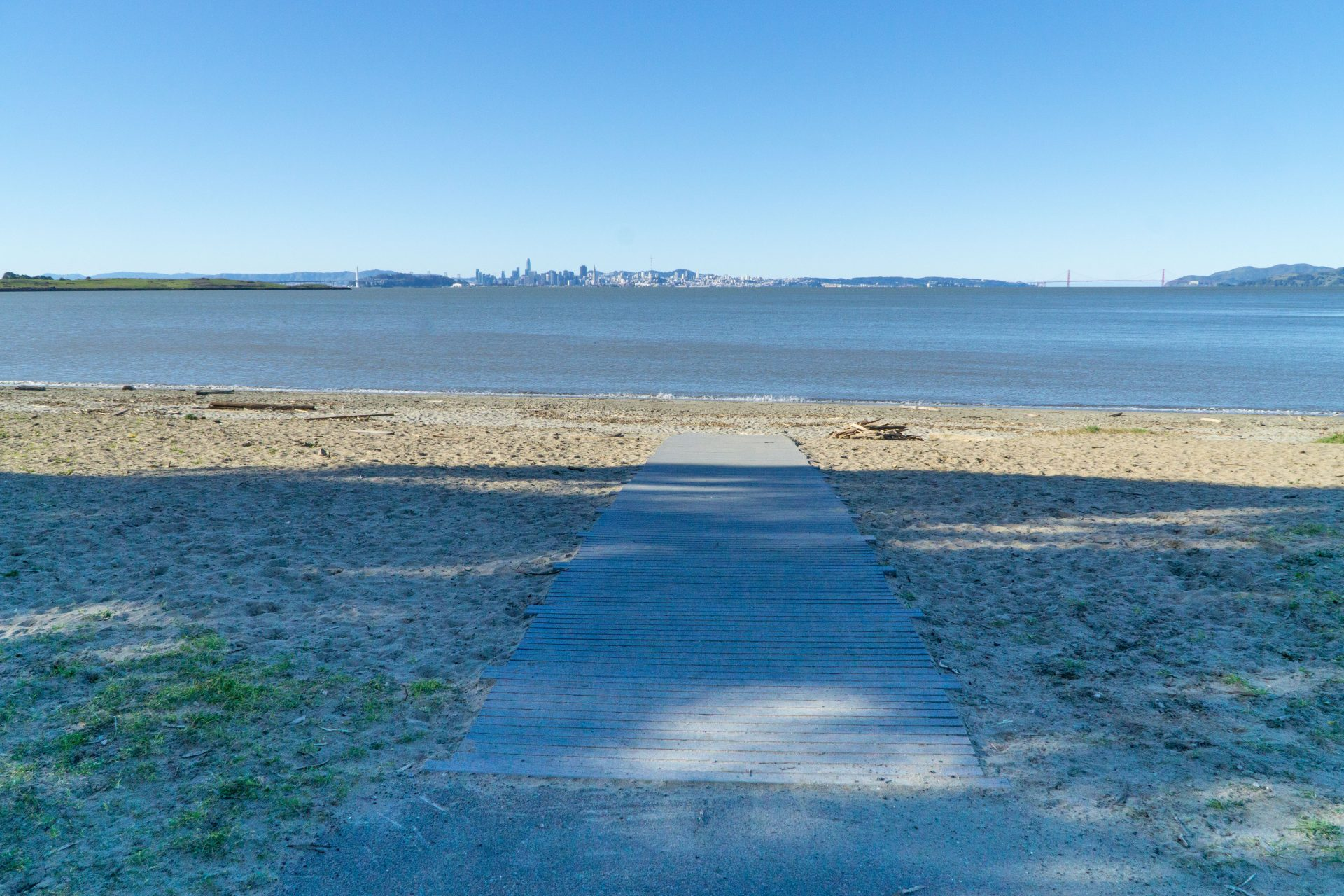 wood gangway over beach to bay, golden Gate in far distance