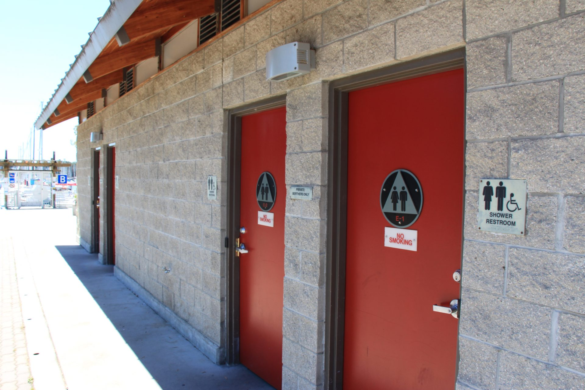Cinderblock building with unisex, accessible showers/restrooms