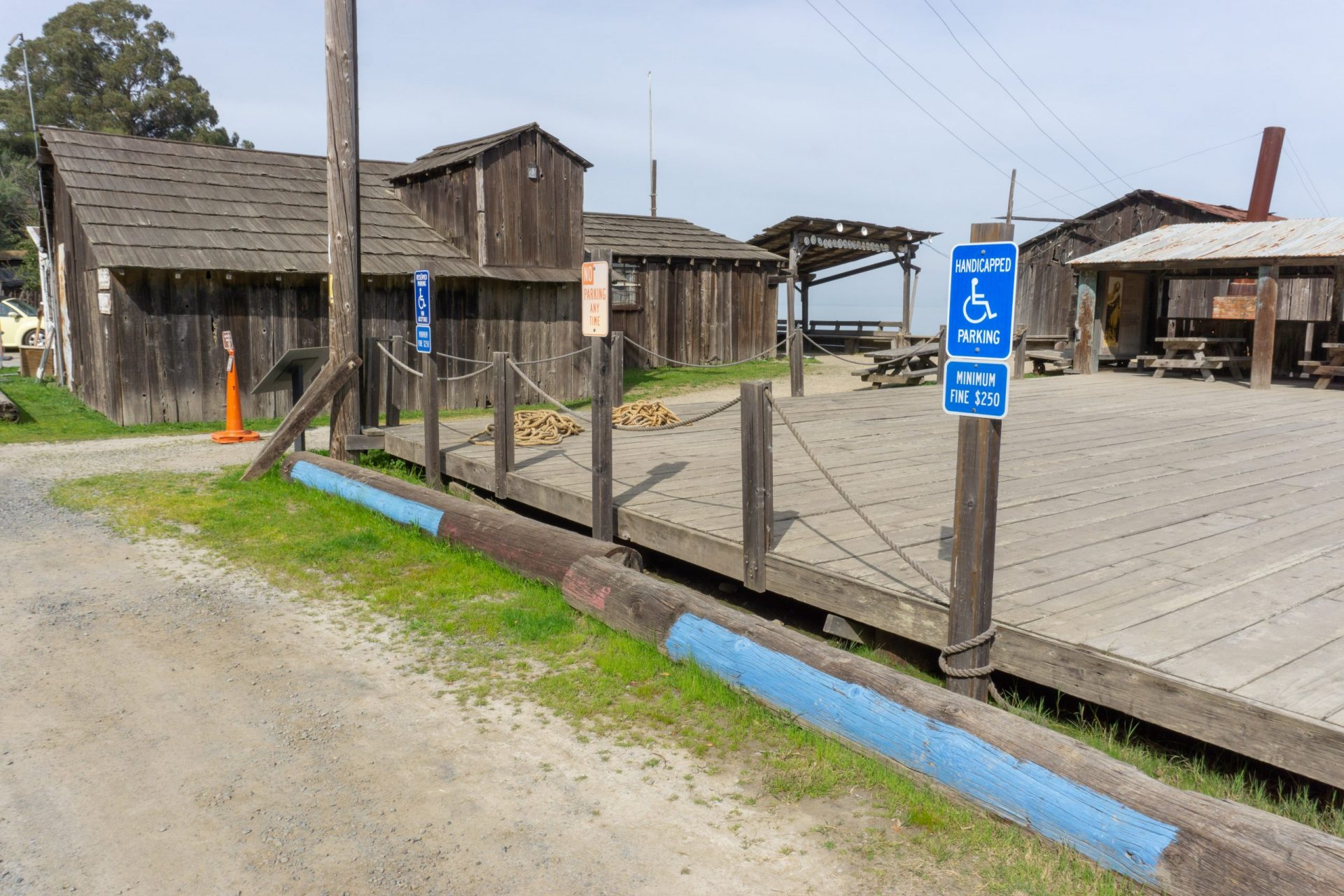 handicap parking space and wooden buildings