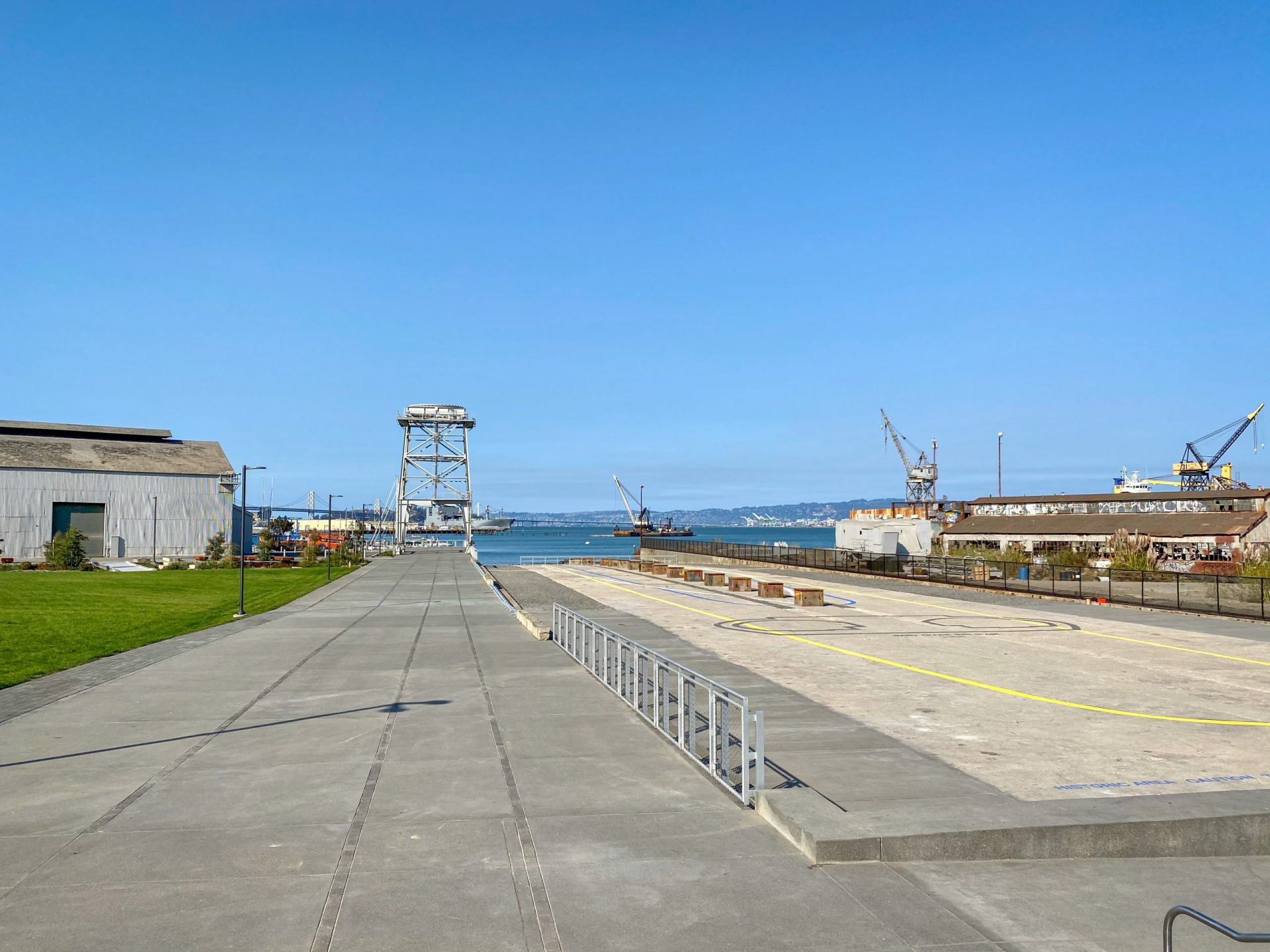 paved area with shipping cranes