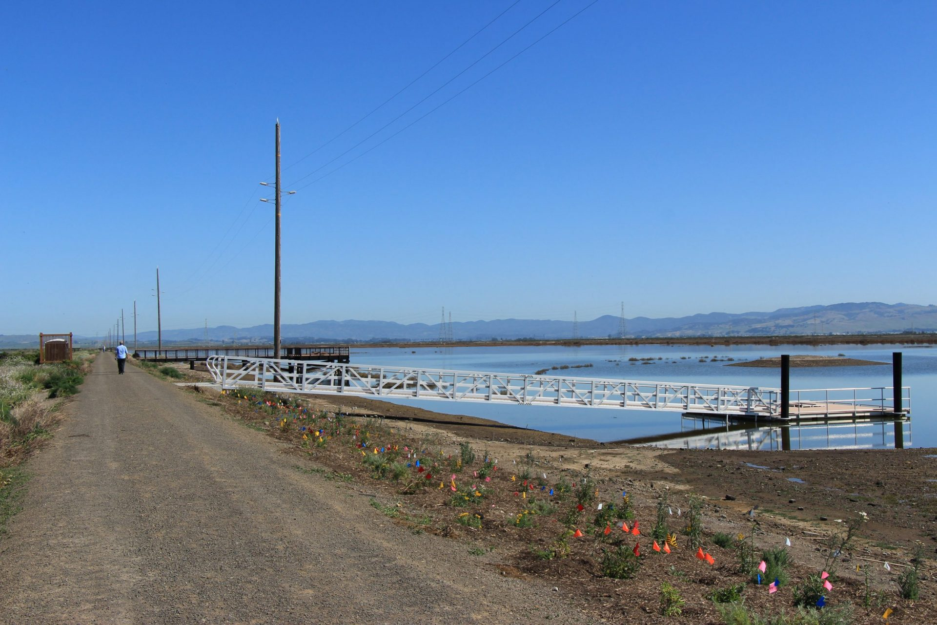 dirt road with ramp to pier