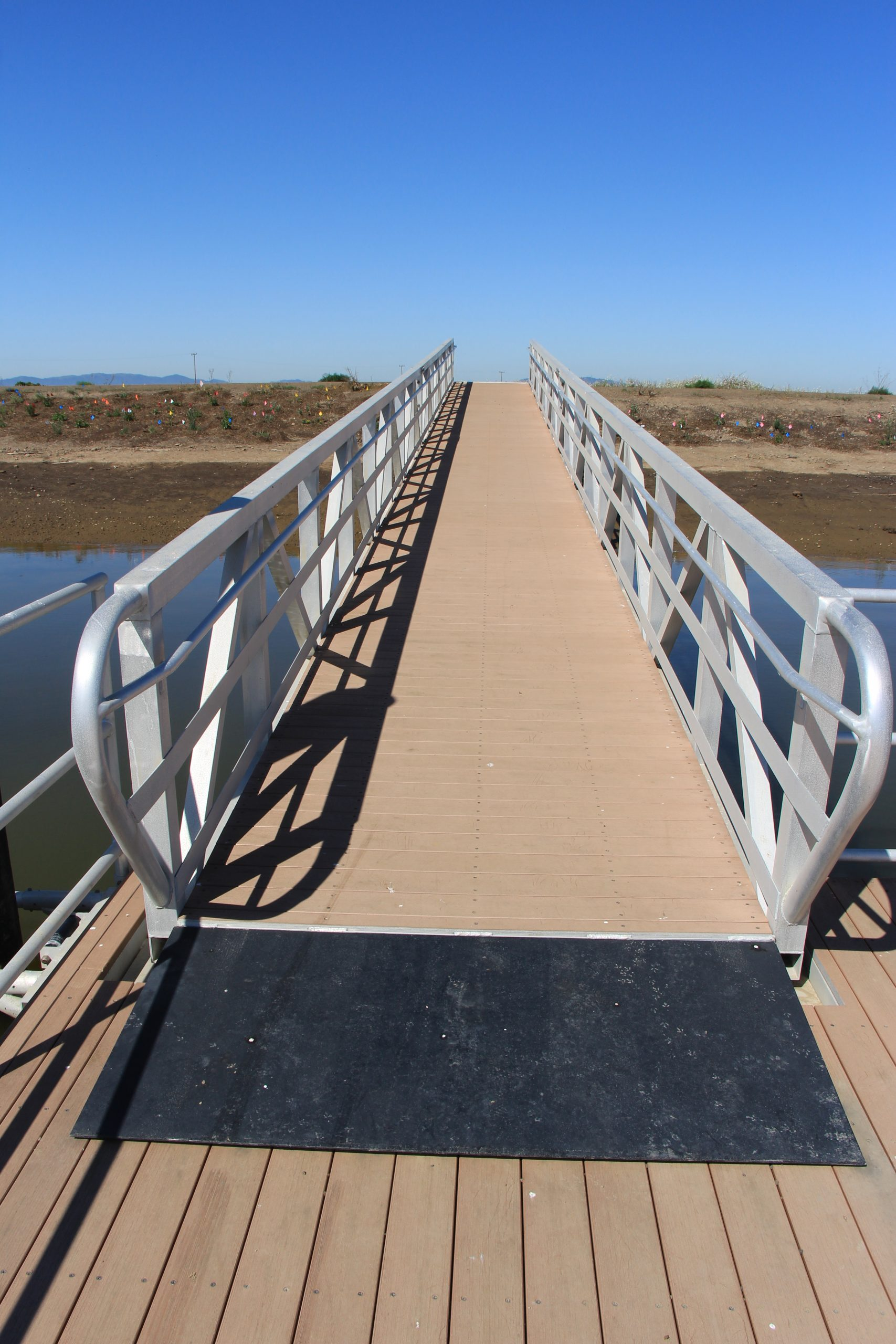 ramp from pier with metal railings on both sides