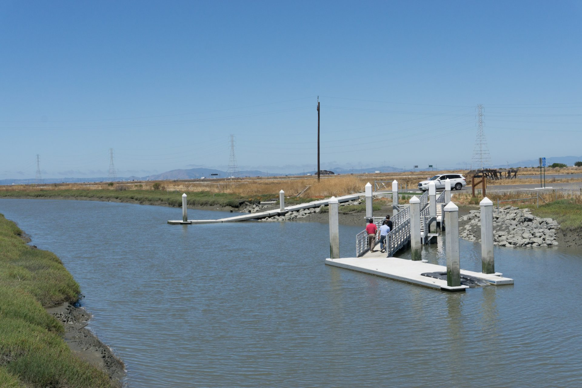 Ramps down to floating dock on narrow channel