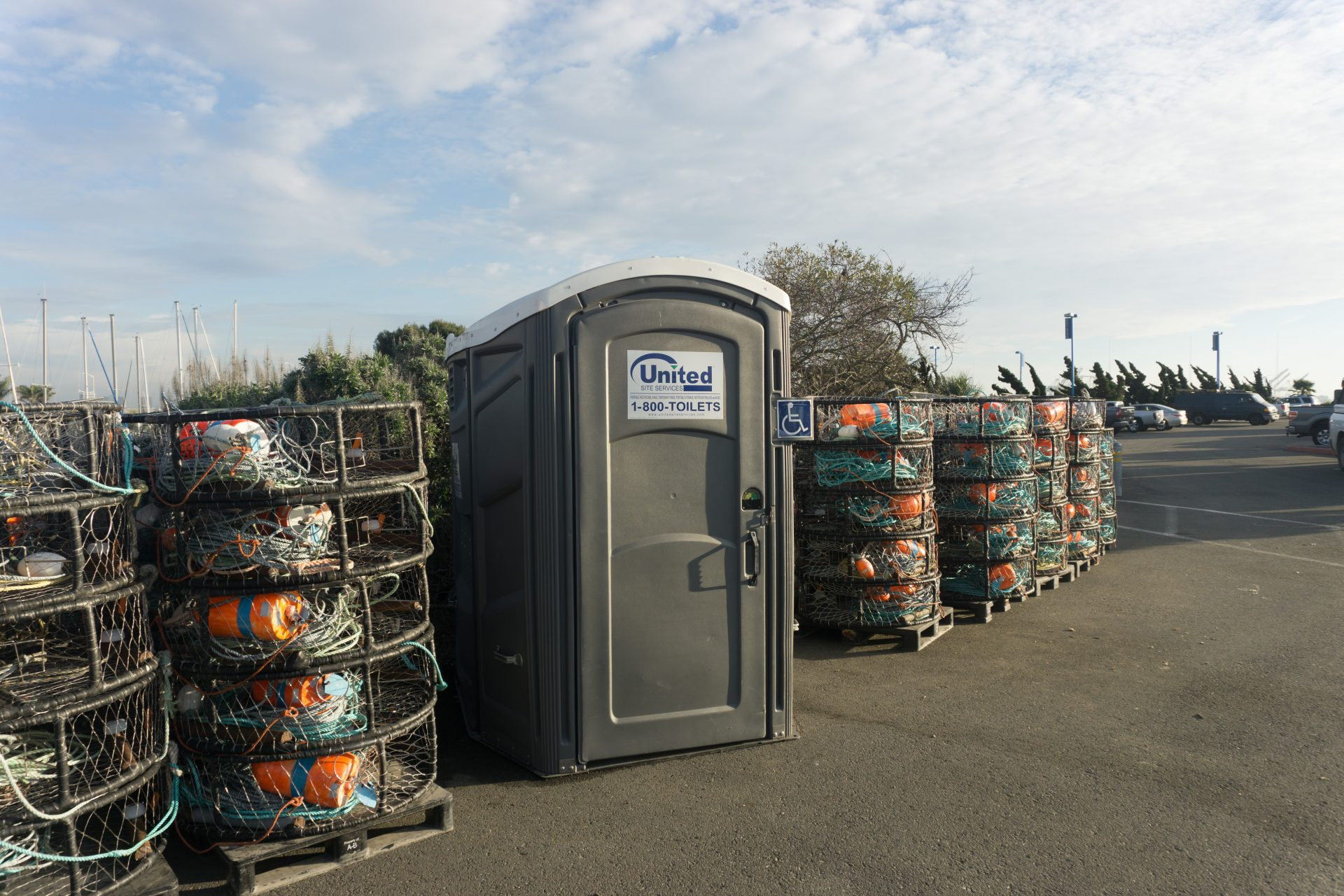 stacks of crab traps on either side of an accessible toilet
