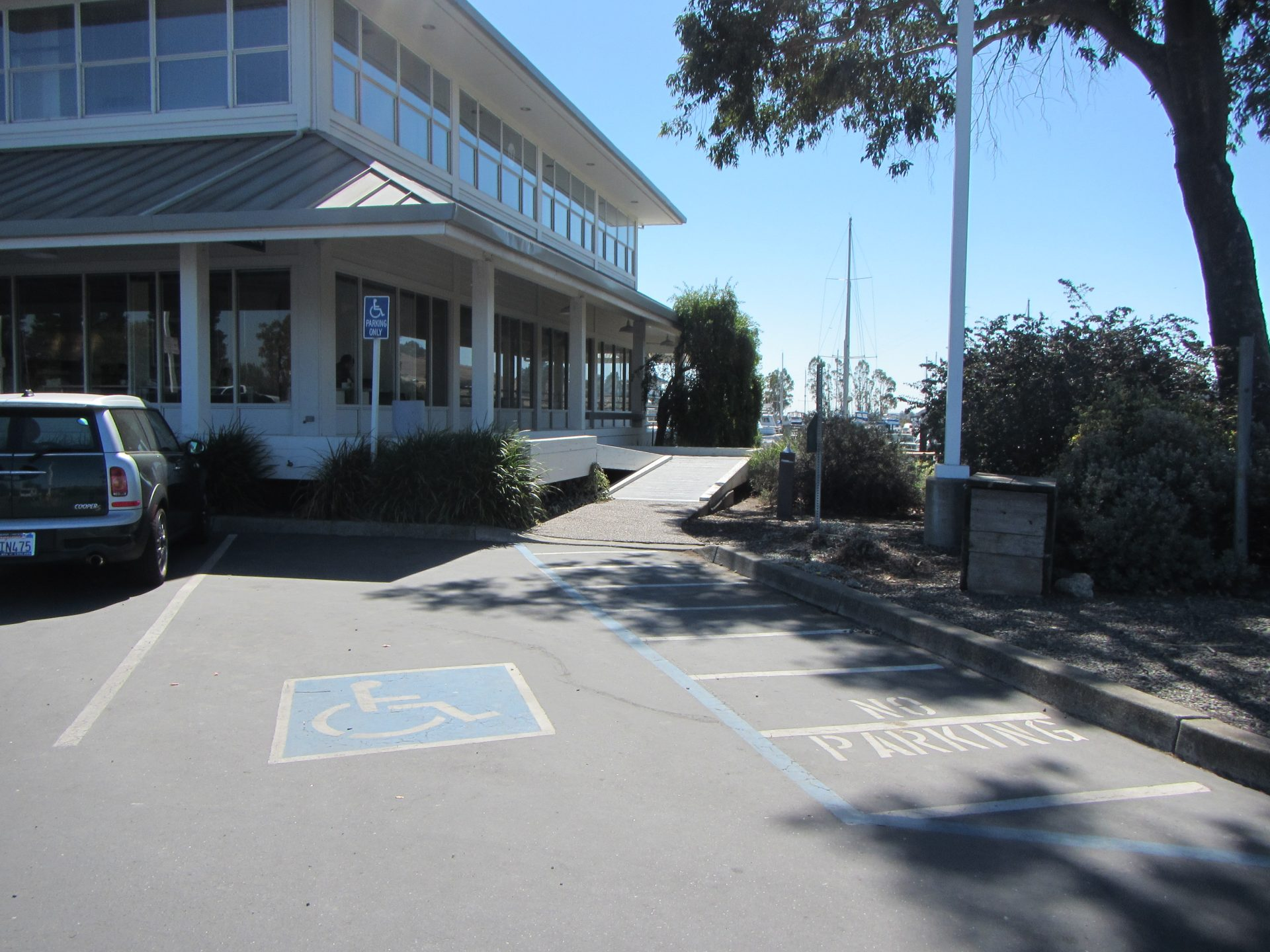 Handicap accessible space with building beyond