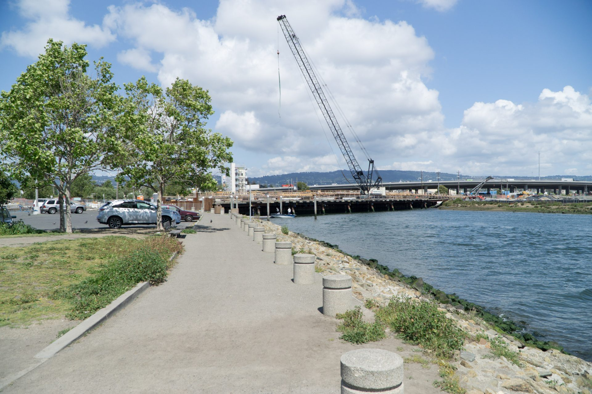 paved path with bollards and bay on right