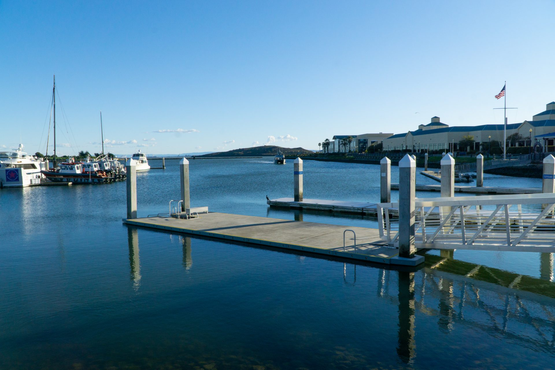 floating pier with sailr boats on left