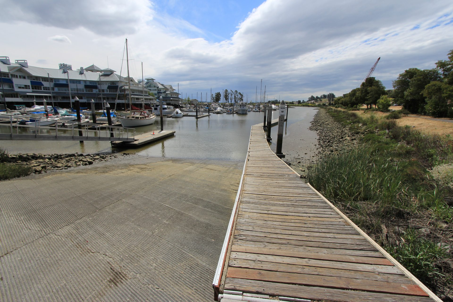 Looking down pathway next to boat ramp, toward water