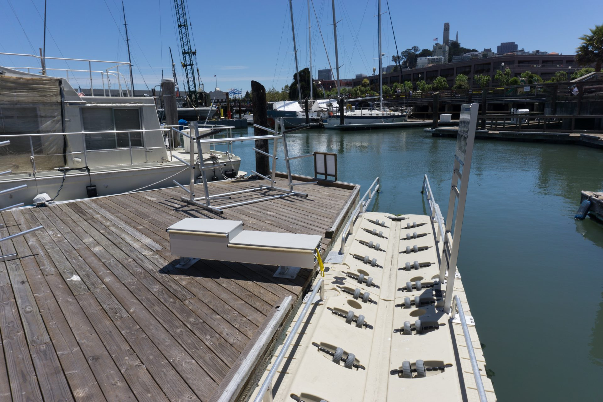 Plastic boat launch with grab bars and rollers