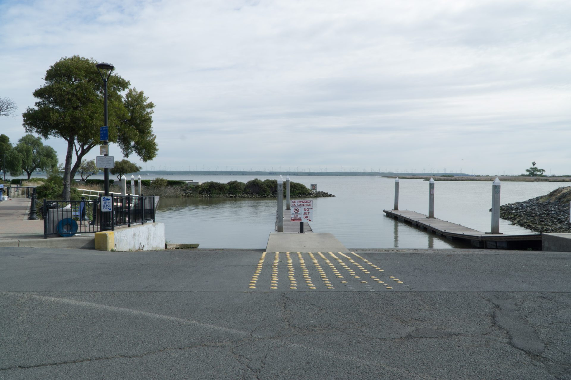 large paved boat launch descends into water