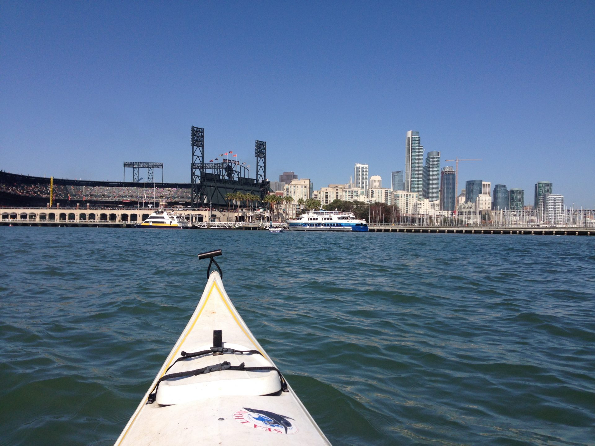 Looking from kayak to ferries stopping at Giants ballpark