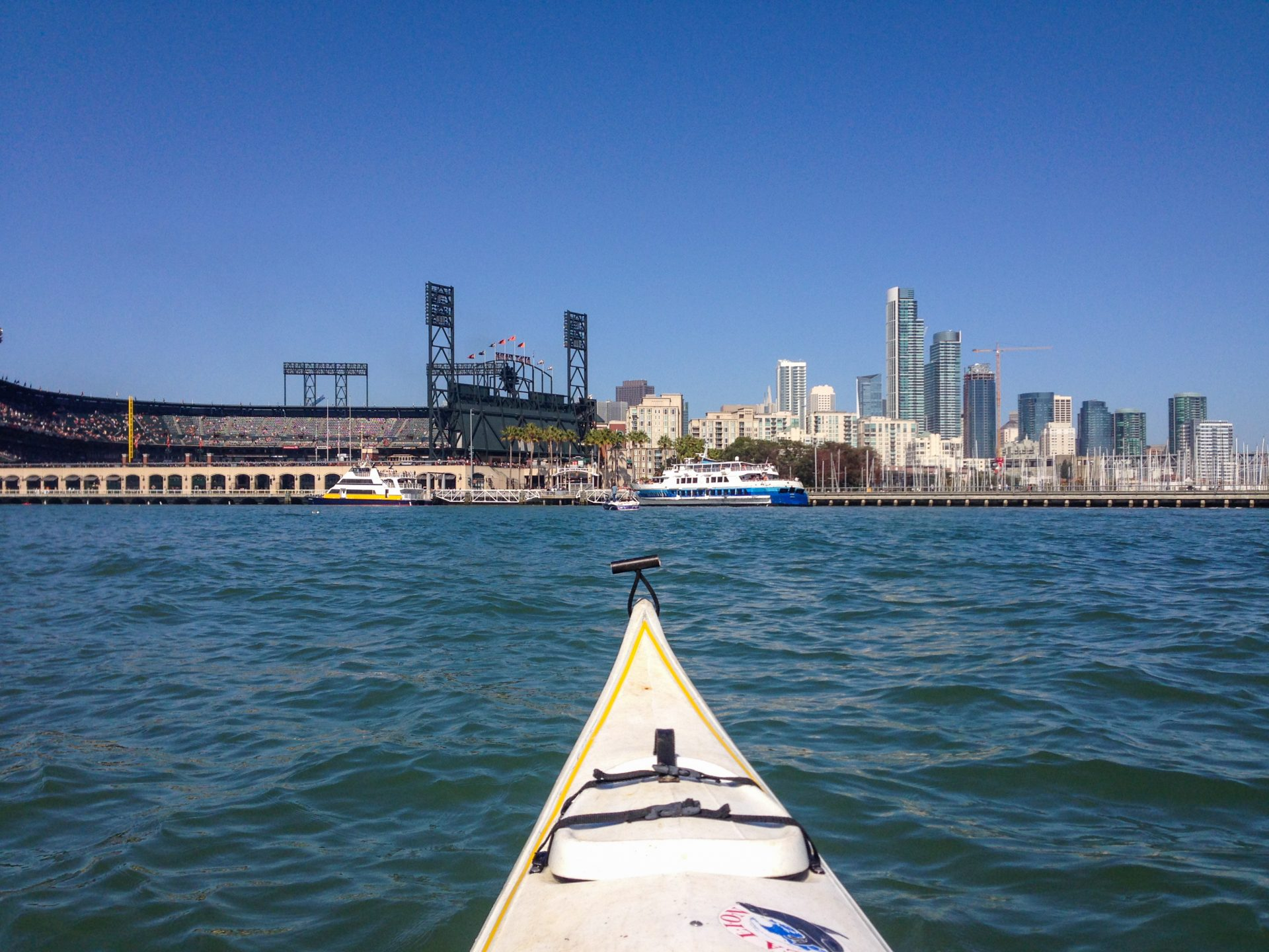 Kayak-level view of ferries going to Giants ballpark