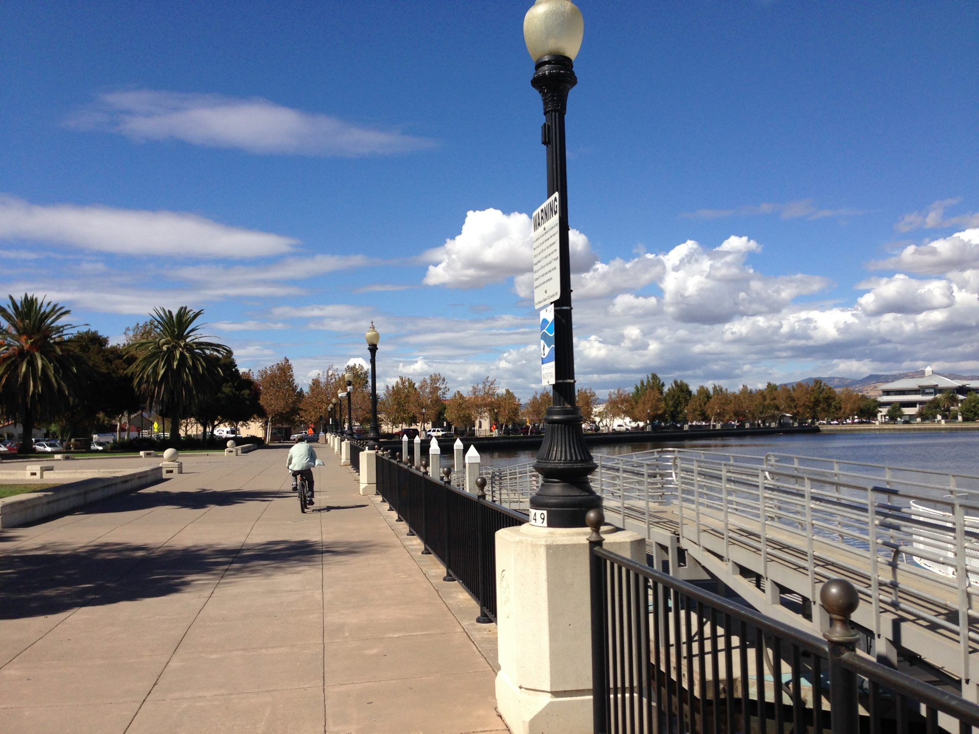 riverfront walkway, with bicyclist