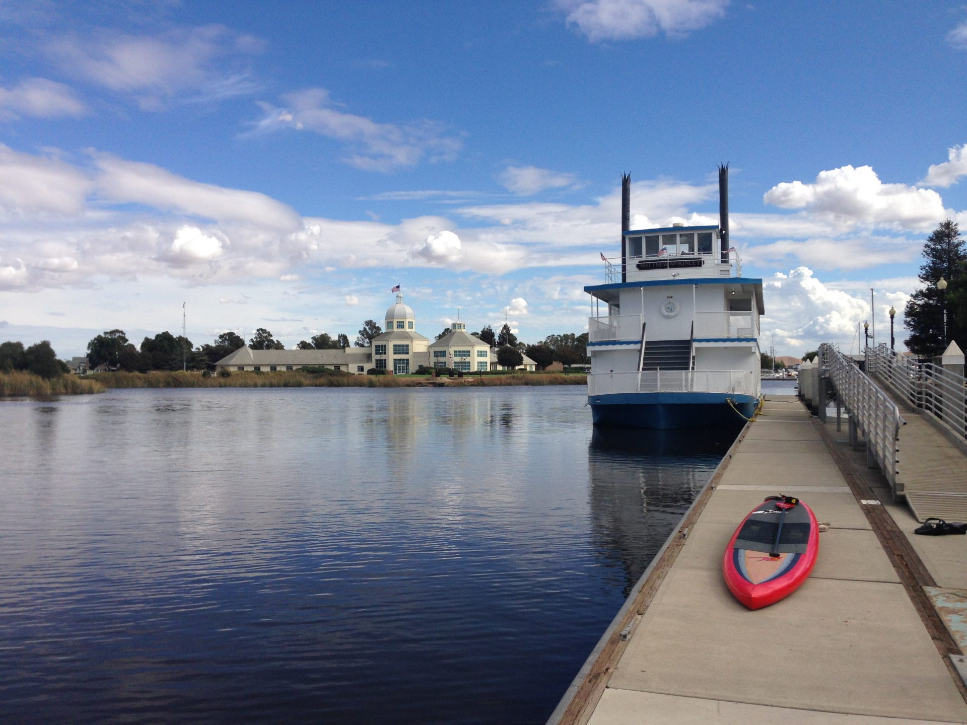 blue sky and water, riverboat moored at dock