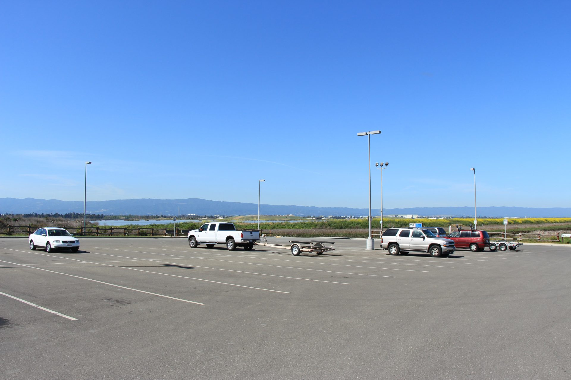 large mostly empty parking lot with long spaces for trucks and boat trailers