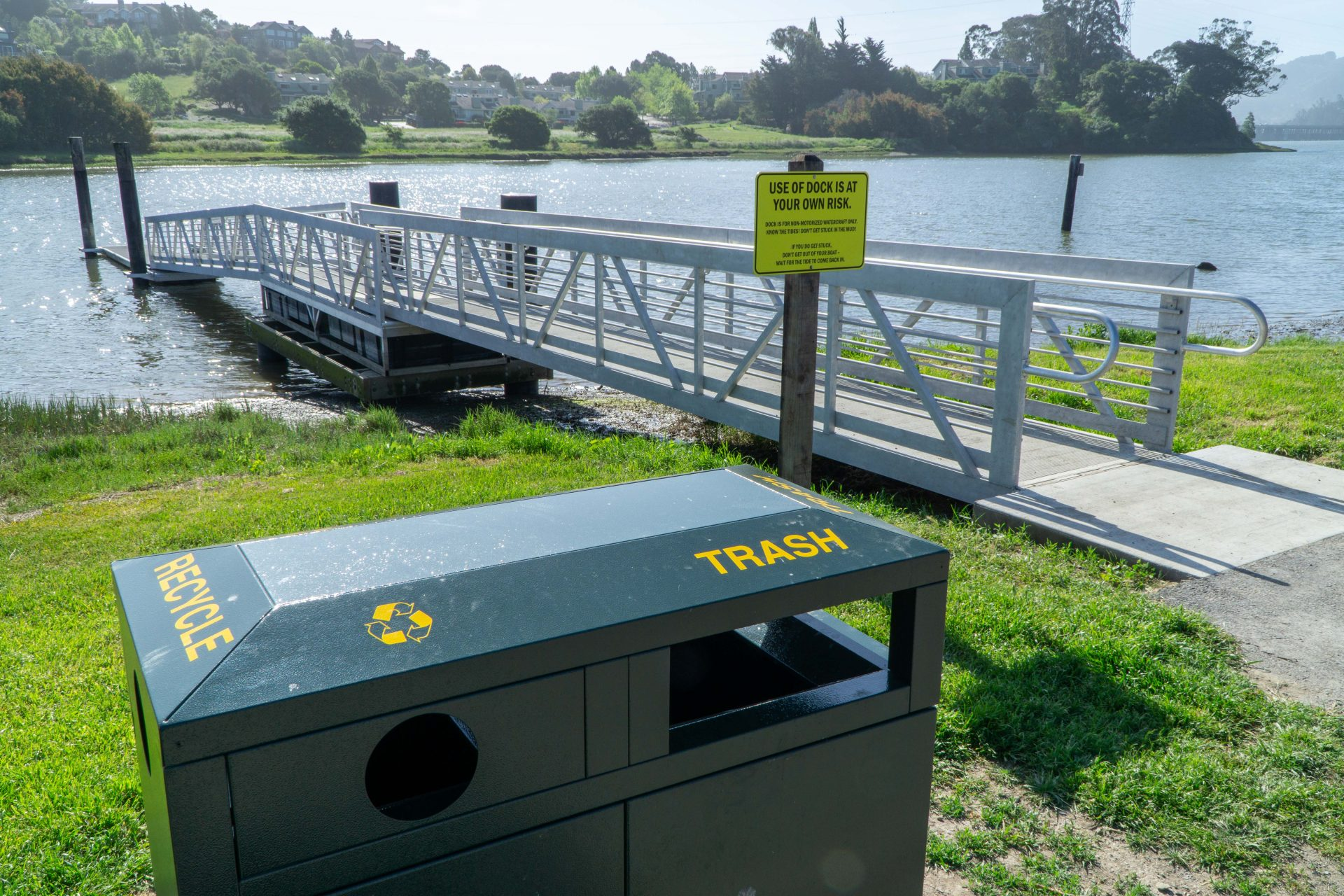 trash cans, ramp to dock beyond