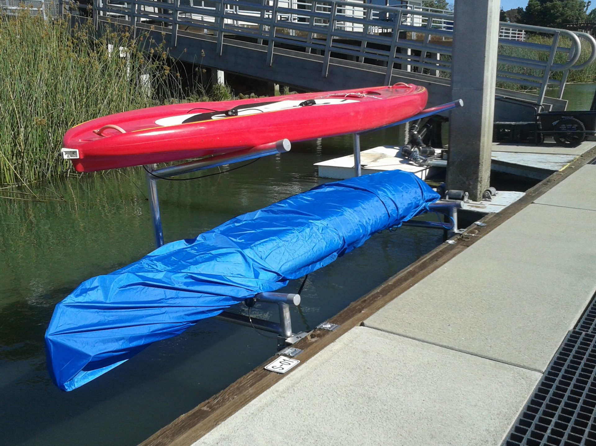 red and blue kayaks in racks
