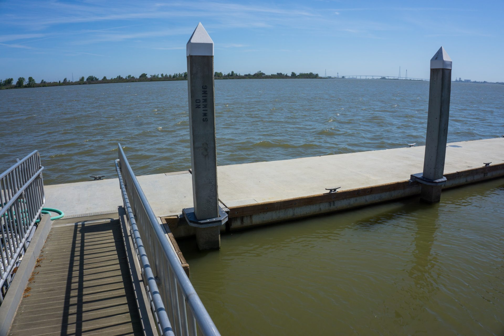 walkway to floating dock attached to two pointed columns