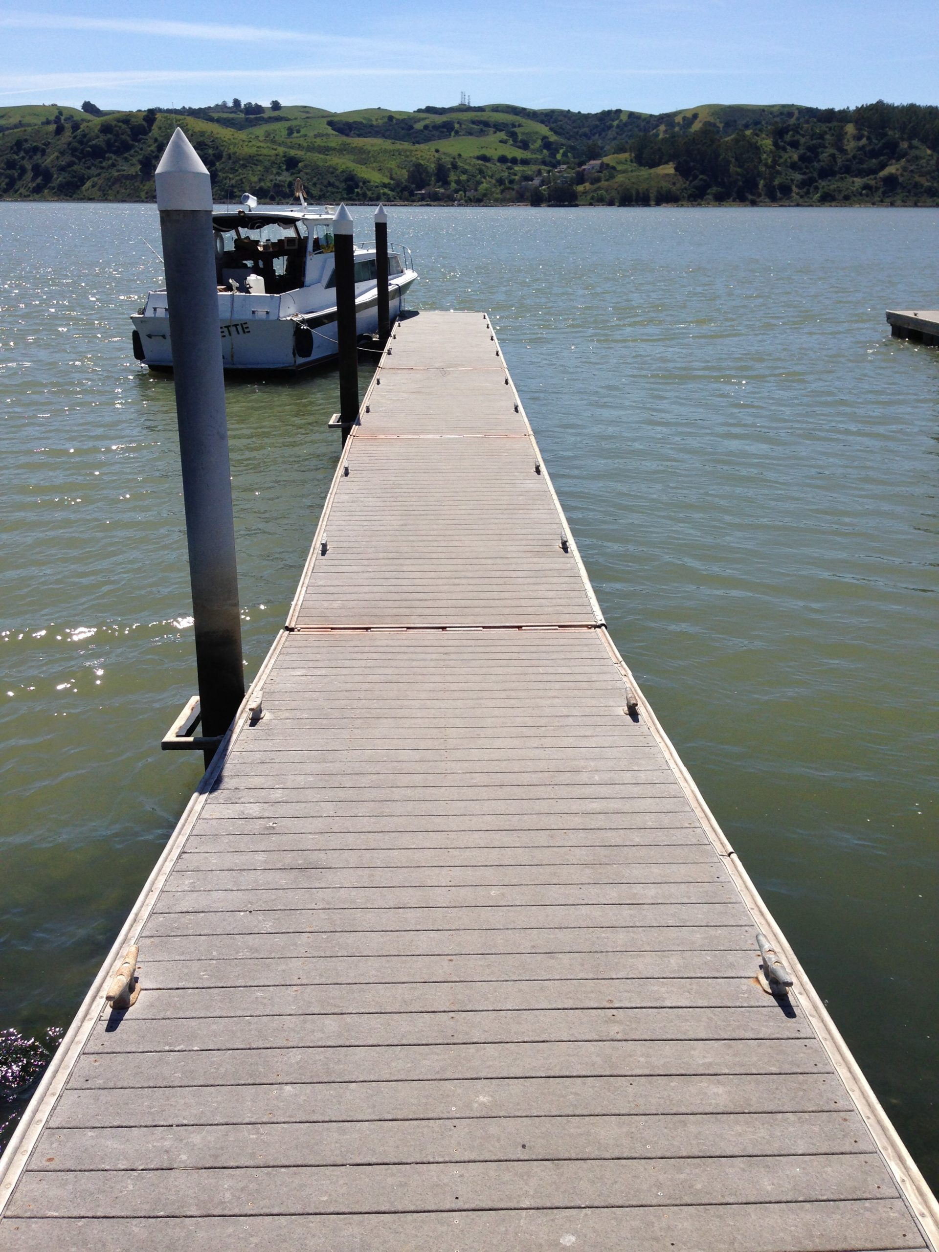 floating dock with boat moored at end