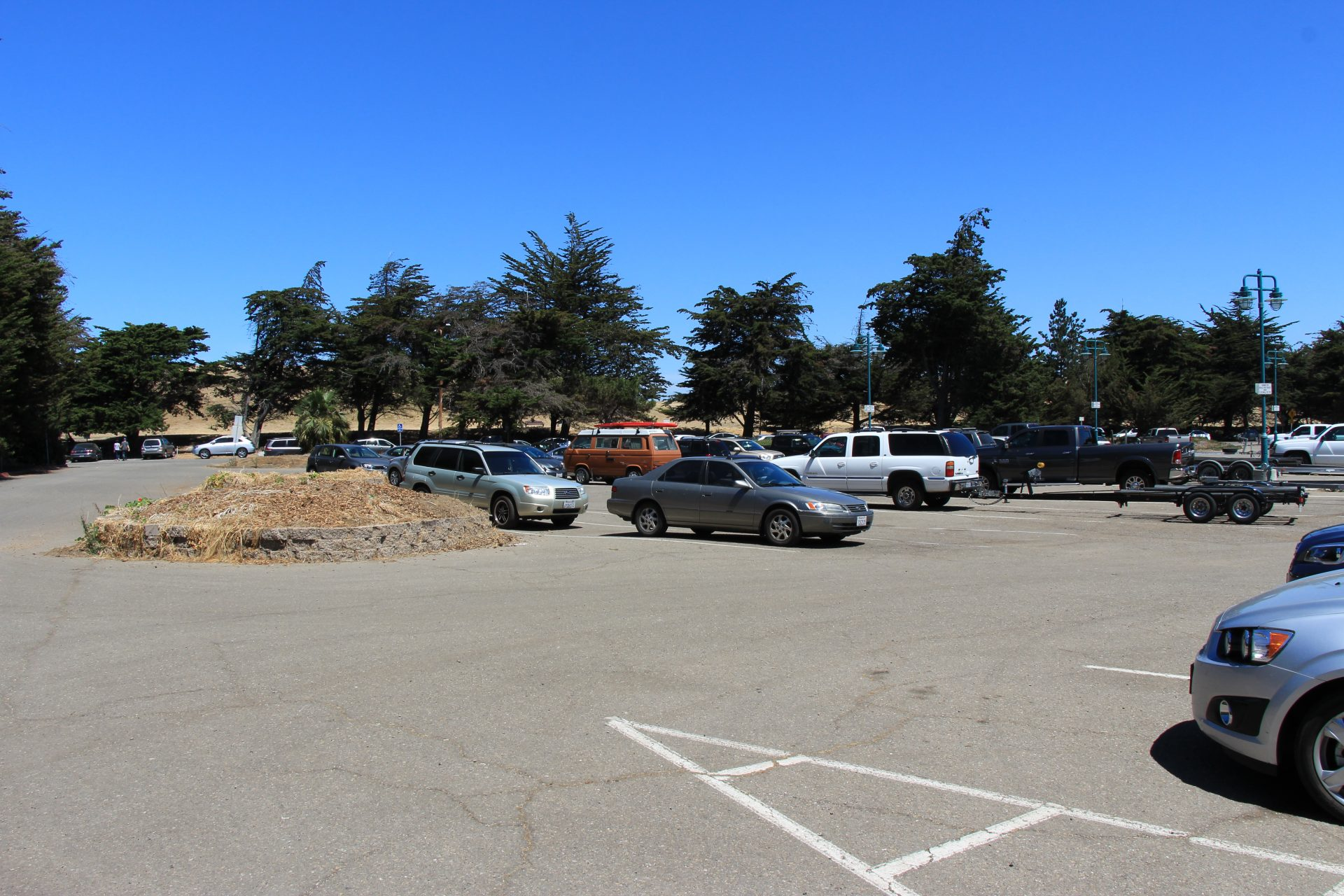Scattered cars in paved parking lot