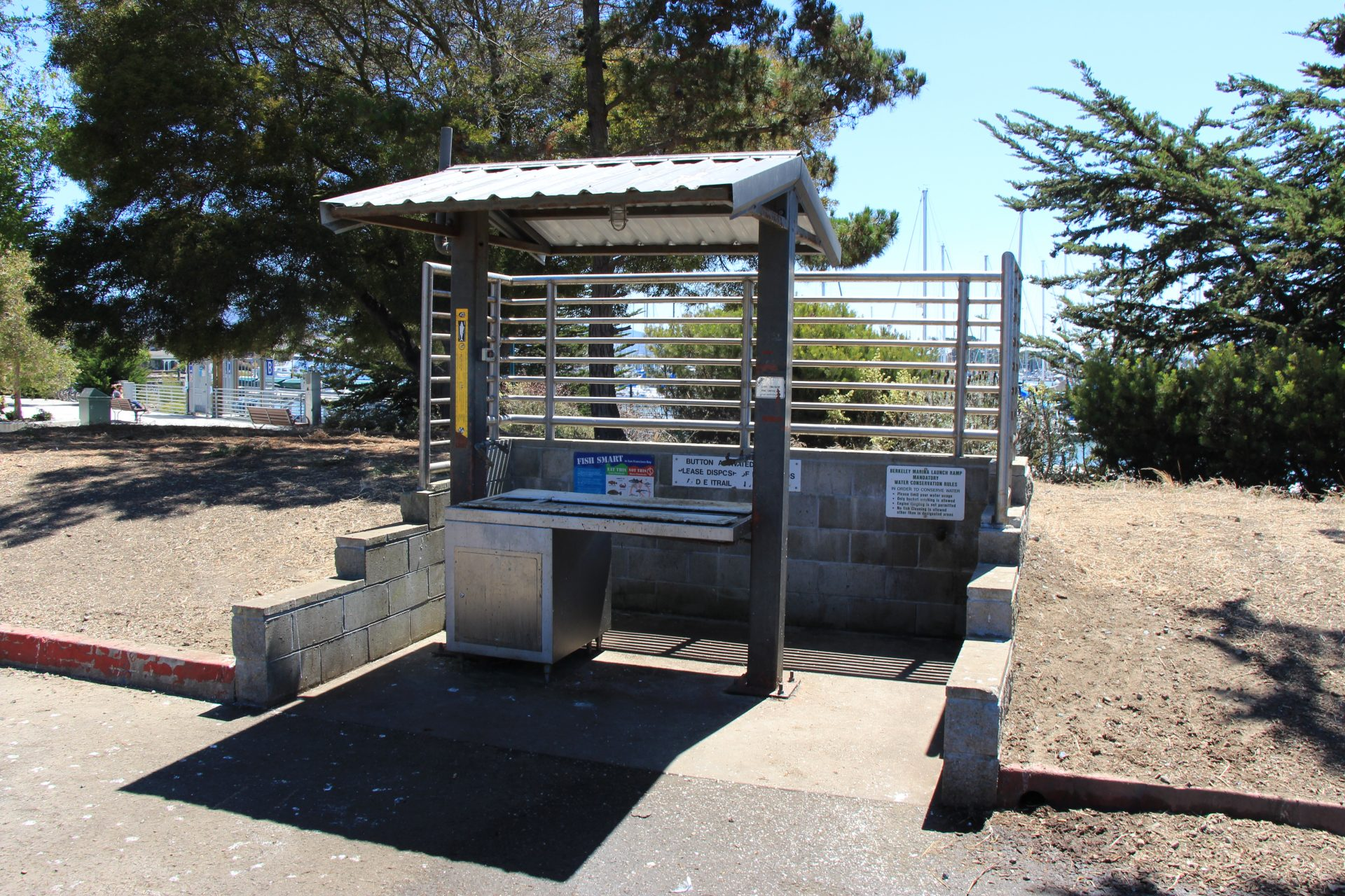Shaded fish cleaning station with steel basin