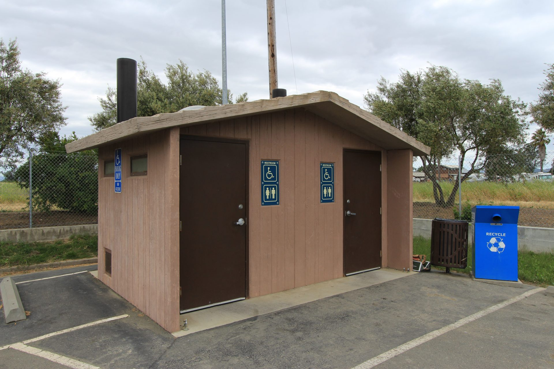 Building with accessible vault toilets