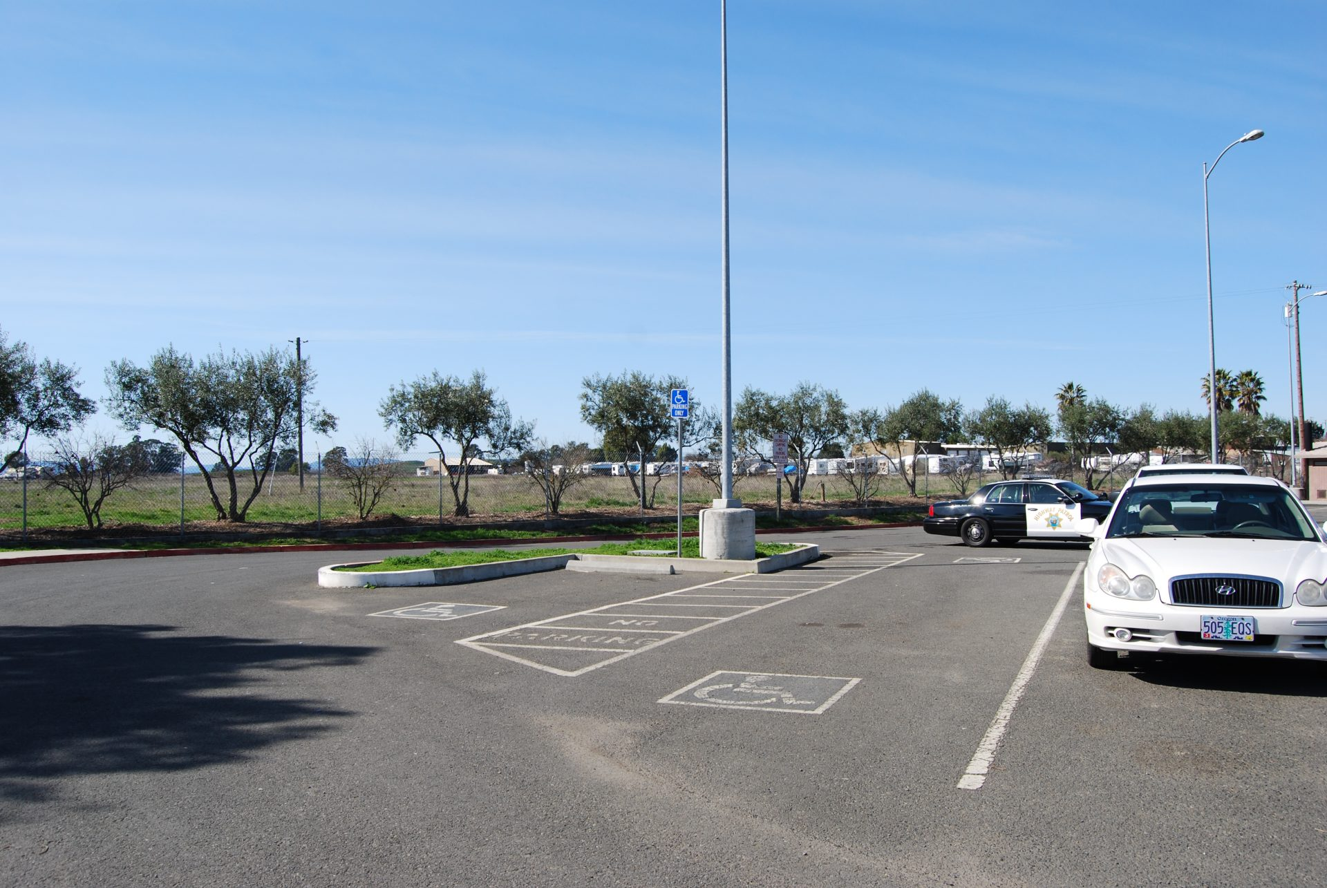 Paved parking lot with three handicap accessible spots