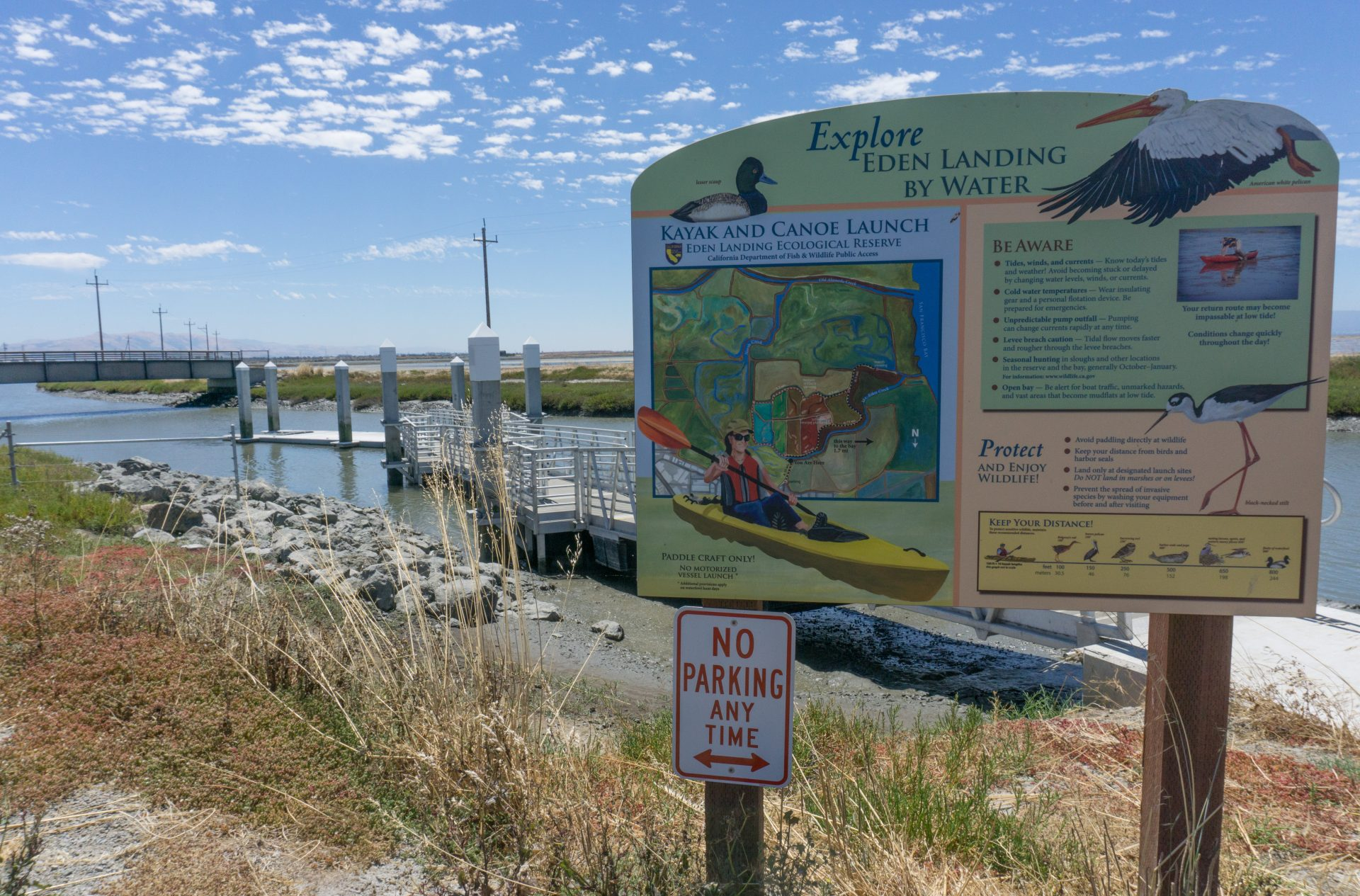 sign: Explore Eden Landing by Water, Kayak and Canoe Launch. Other text illegibile