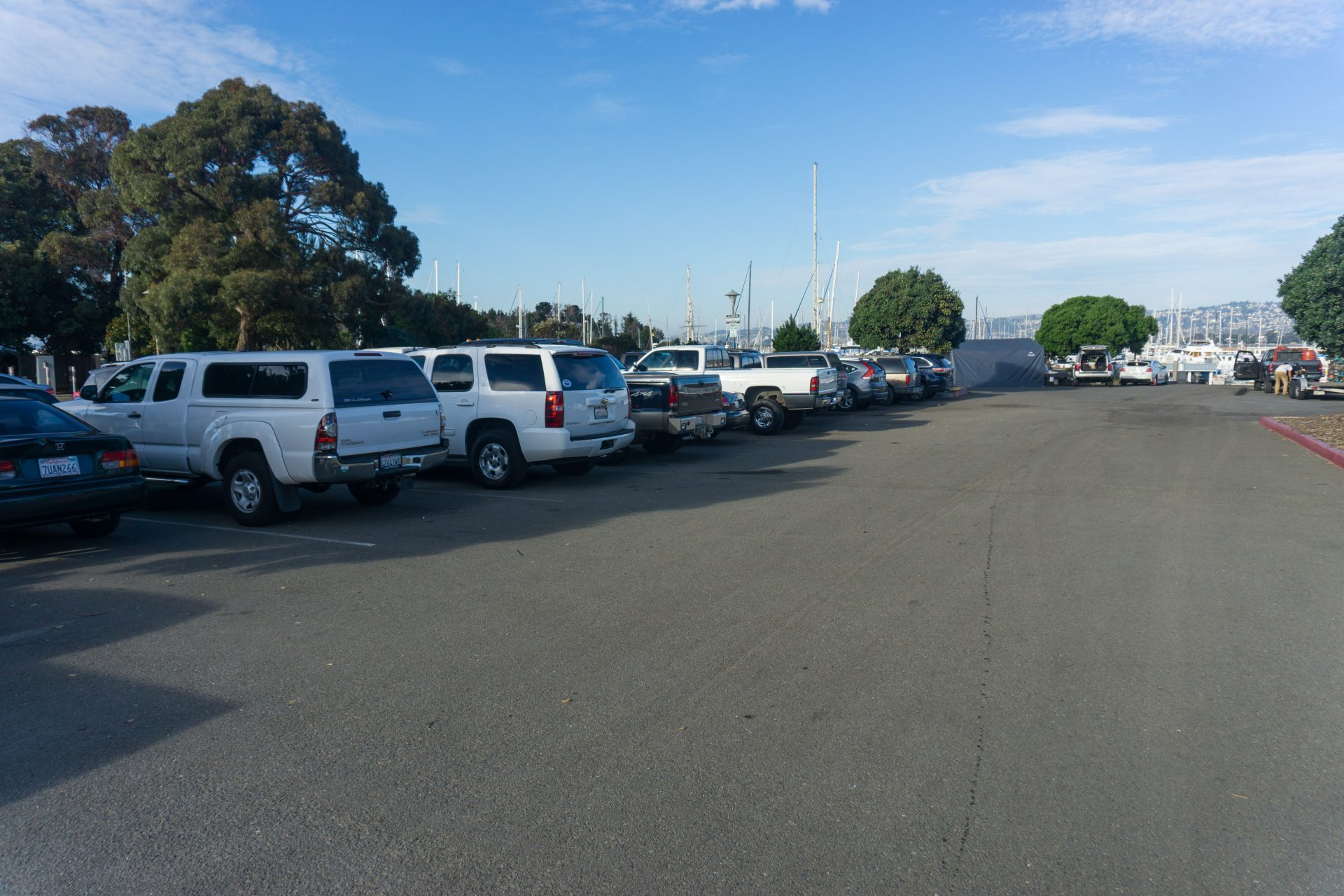 Parking lot full of mostly pickup trucks and SUVs
