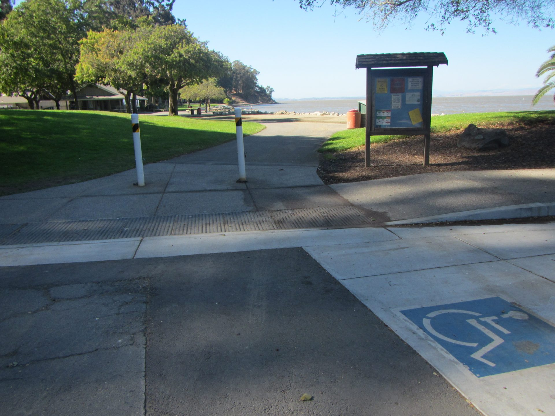 wheelchair-friendly curb cut with access to wide paved walkway