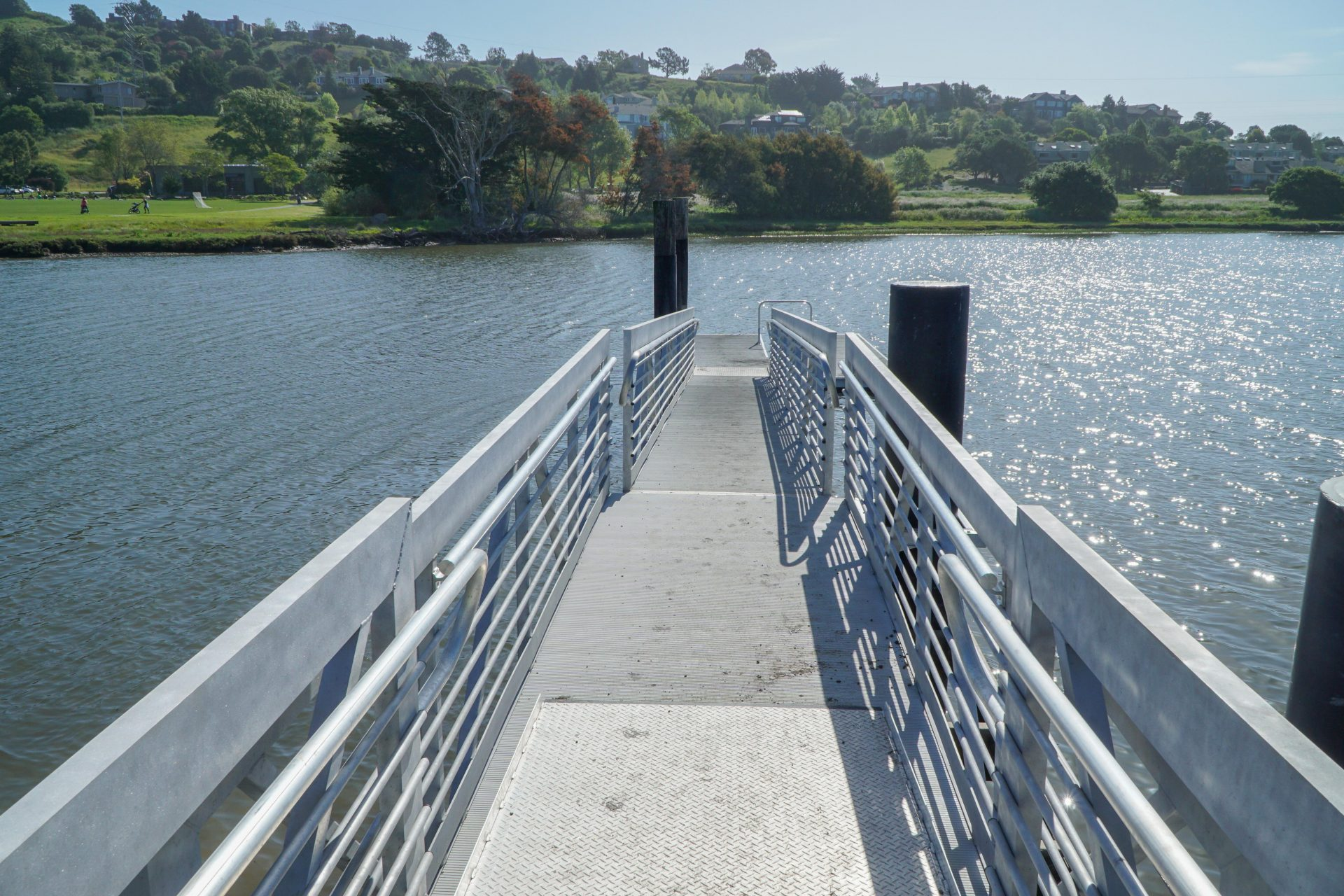 metal pier with railings down to water