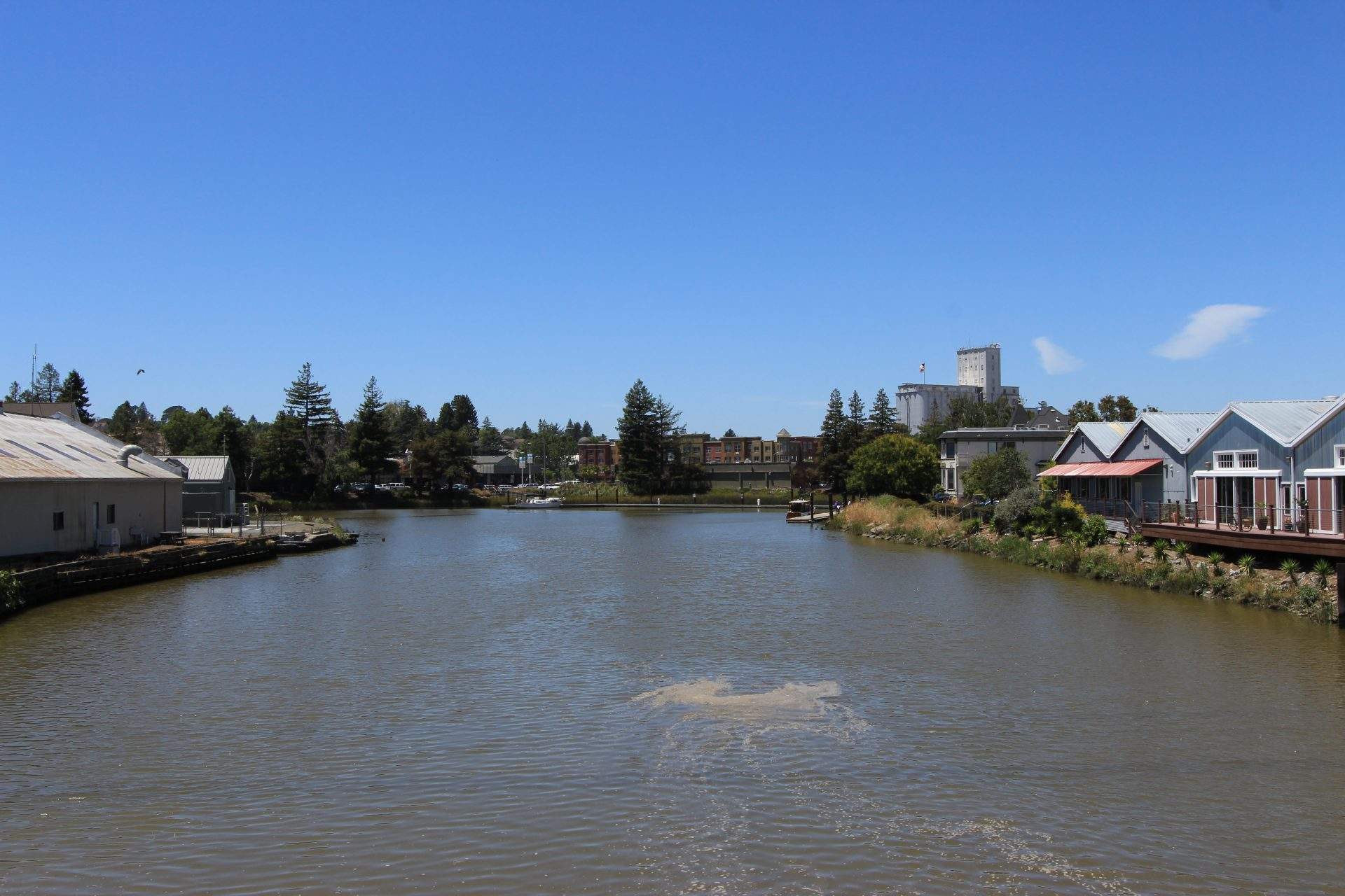 View of river, a wide expanse of water with buildings on both sides