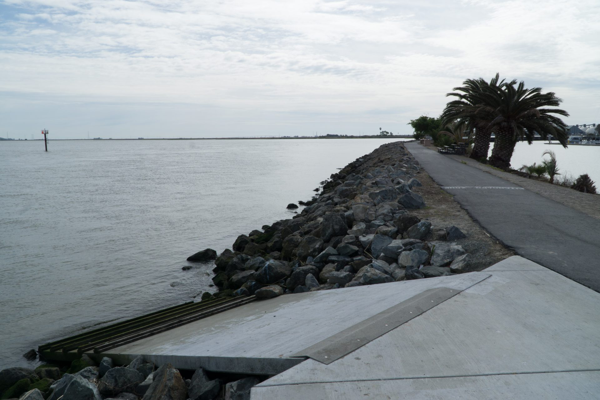ramp into water splits to left from paved path