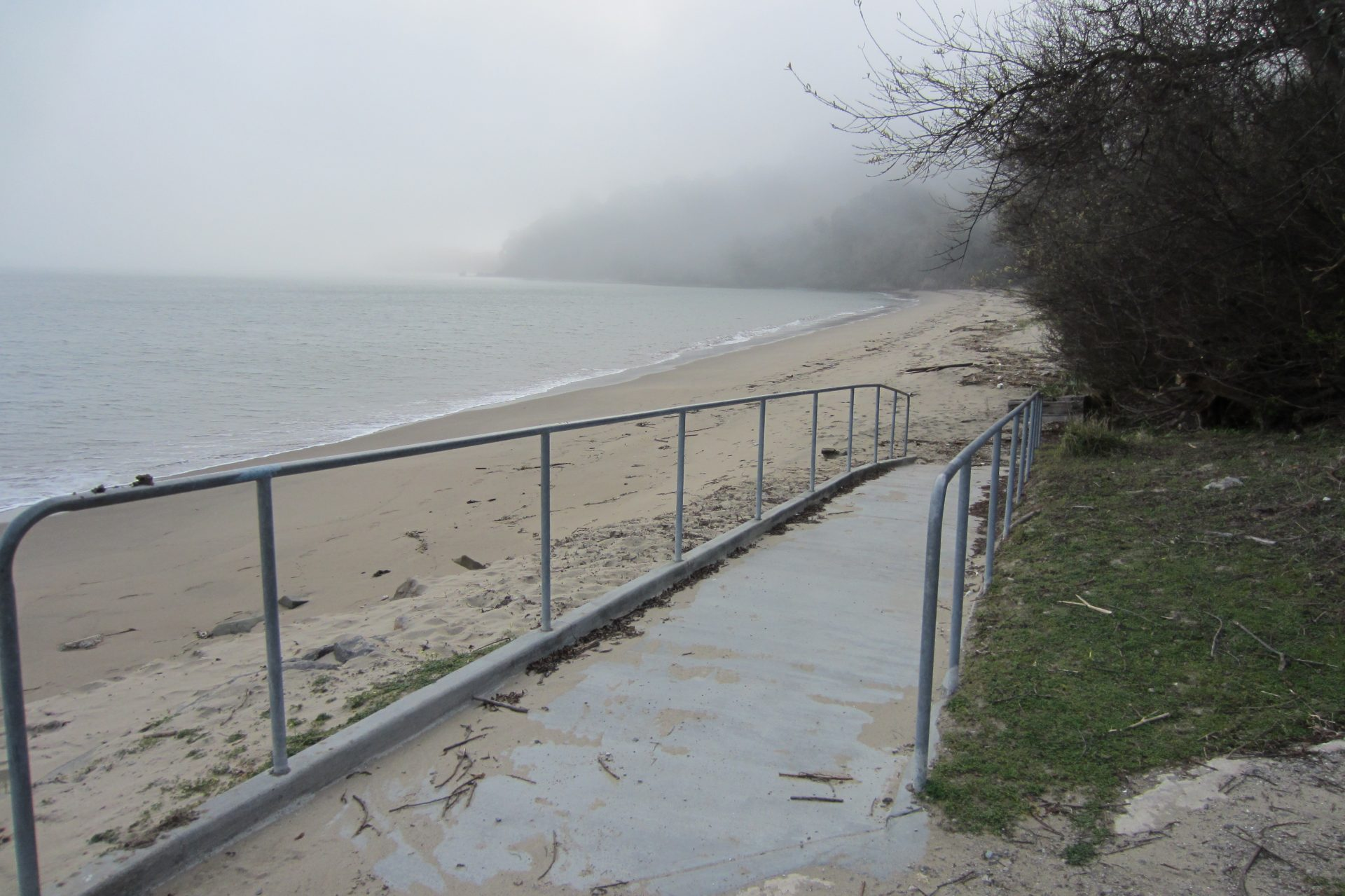 Concrete ramp with railings down to beach