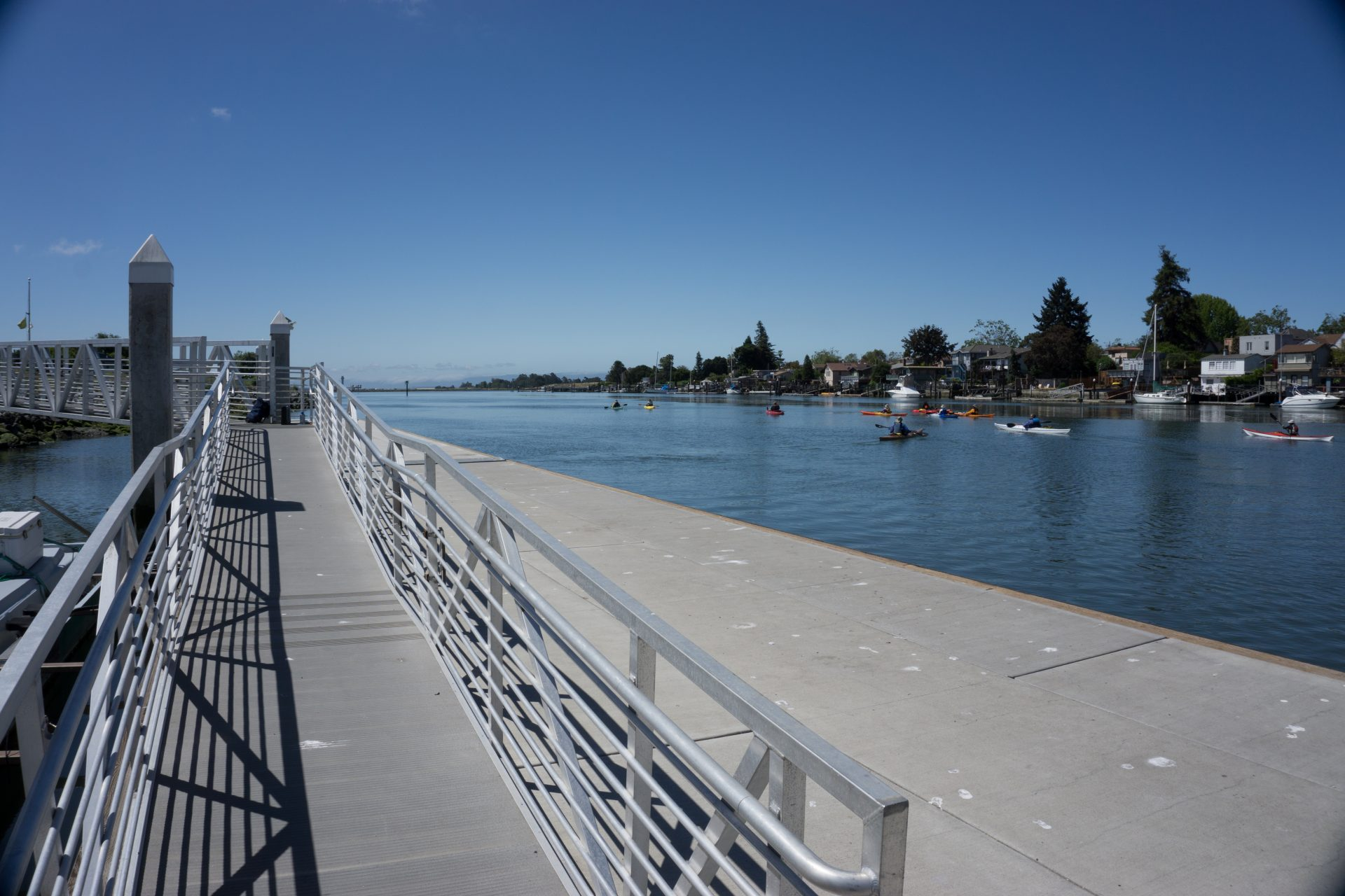 Long ramp with railings on left, lower floating dock on right